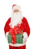 Isolated Santa Holding Christmas Gift Stock Photography