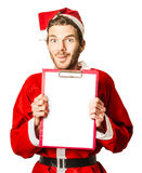 Isolated santa holding christmas wish list Stock Image