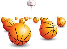Isolated scattered basketballs. With hoop in the background Stock Photography