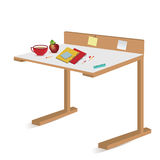 Isolated school desk with notebooks and pencils Royalty Free Stock Image