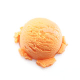 Isolated scoop of mango ice cream. High angle view on a scoop of mango ice cream isolated on white background Royalty Free Stock Photography