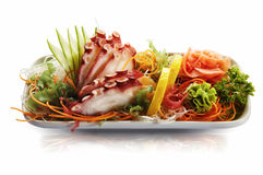 Isolated seafood set on white plate Stock Photos