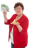 Isolated senior woman with money: concept for pension and herita Royalty Free Stock Image