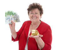 Isolated senior woman with money: concept for pension and herita. Isolated happy senior woman with money: concept for pension and heritage Royalty Free Stock Photos