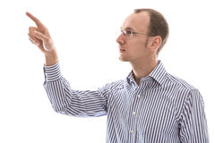 Isolated serious man in blue shirt pointing with his finger side Royalty Free Stock Image