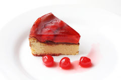 Isolated served slice of delicious cherry cheese cake Stock Images