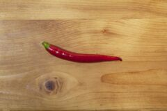 Free Isolated Shiny Red Hot Chilli Pepper From The Organic Biological Vegetable Garden Farm On A Natural Wooden Table Top From Above Royalty Free Stock Photos - 211305298