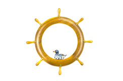 Isolated ship steering wheels art frame with wooden bird toy Royalty Free Stock Photo