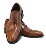 Isolated shoes with clipping path. Brown leather executive shoes. Clipping path included Royalty Free Stock Photos