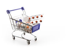 Isolated Shopping Cart Full With Pills And Capsules Stock Photo
