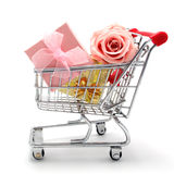 Isolated shopping cart with gift boxes and rose Royalty Free Stock Photo