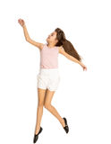 Isolated shot of cute girl dancing and jumping up high Stock Image