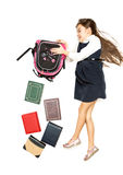 Isolated shot of cute schoolgirl emptying backpack full of books Royalty Free Stock Image