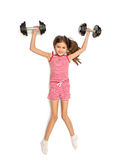 Isolated shot of cute smiling girl lifting up two bug dumbbells Stock Images