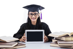 An isolated shot of female graduate show blank touchpad Stock Photos