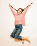 Isolated shot of happy girl with long braids jumping up high Stock Photography