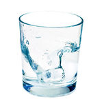 Isolated shot of ice cube being dropped in water Stock Image