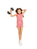 Isolated shot of little girl lifting heavy dumbbell Royalty Free Stock Image