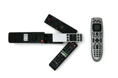 Universal Remote. Isolated shot of multiple remotes pointing to one universal remote Royalty Free Stock Photography
