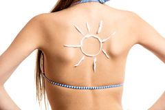 Isolated shot of sun drawn by sun lotion on girls back royalty free stock photo
