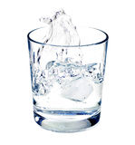 Isolated shot of water splashing  in a glas Royalty Free Stock Photos