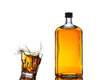Isolated shots of whiskey with splash on white Stock Images