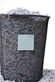 Isolated Shredded Paper. In a Basket with a Blank Note Royalty Free Stock Photo