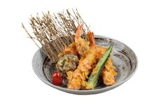 Isolated Shrimp and shiitake tempura with chilli served in ink painted round stone plate.  stock photography