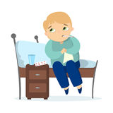 Isolated sick boy. Isolated sick boy sitting in bed with fever on white background Stock Image