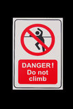 Isolated sign of DANGER! Do not climb with black background Stock Image