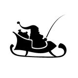 Isolated Silhouette of Santa Claus riding a sleigh. Silhouette of Santa Claus riding a sleigh with sacks of gifts. Isolated black  on white Royalty Free Stock Photos