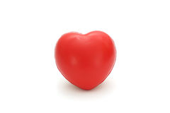 Isolated single simple red sponge heart on white background Stock Images