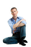 Isolated sitting on the floor man Royalty Free Stock Photos
