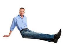 Isolated sitting on the floor man Stock Photo