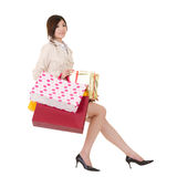 Isolated sitting shopping woman Royalty Free Stock Photography
