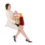 Isolated sitting shopping woman Royalty Free Stock Image