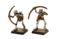 Isolated Skeleton Miniatures. Two painted skeleton models isolated on a white background. For use in fantasy roleplaying games such as Dungeons & Dragons Royalty Free Stock Images