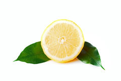 Isolated slice of lemon with two leaves Stock Photo