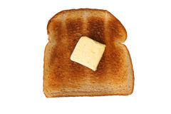 Isolated slice of toast with butter Royalty Free Stock Images