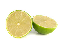 Isolated sliced green lime on a white background. (half). Fresh diet fruit (health). Healthy fruit with vitamins Royalty Free Stock Image