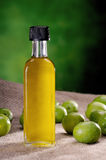 Isolated small bottle of olive oil on canvas Stock Photography