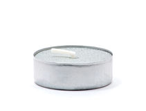 Isolated small candle. Isolated macro shot of small silver candle over white royalty free stock photos