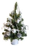Isolated small christmas tree. Isolated christmas tree with silver decoration - bells, beads and  boxes Stock Images
