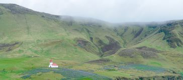 Isolated wooden church with red roof - Iceland stock photography
