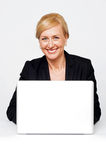 Isolated smiling corporate lady working on laptop Stock Images