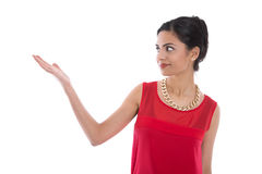 Isolated smiling indian woman in red presenting with her hand. Stock Photos
