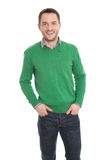 Isolated smiling man with green pullover on white. Royalty Free Stock Photos