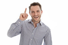 Isolated smiling man with his forfinger Stock Photography