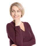 Isolated smiling middle aged woman in fall clothes looking sideways. Isolated smiling middle aged woman in fall clothes looking sideways to text royalty free stock image