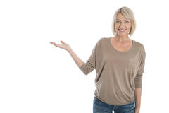 Isolated smiling older or mature woman presenting with hand over